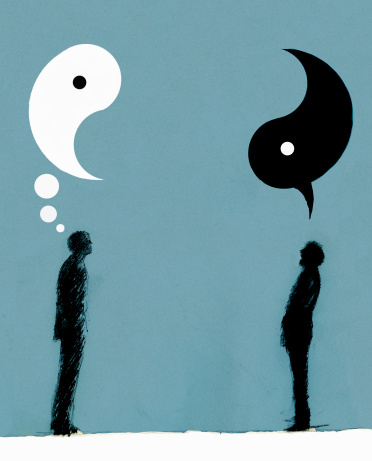Businessmen with yin and yang speech and thought bubbles overhead